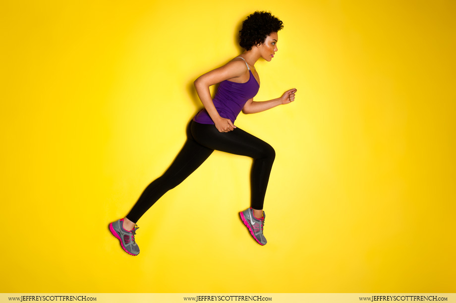 An image of a woman running wearing activewear on a yellow background by Jeffrey Scott French