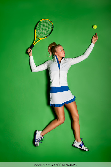 An image of a woman playing tennis wearing activewear on a green background by Jeffrey Scott French