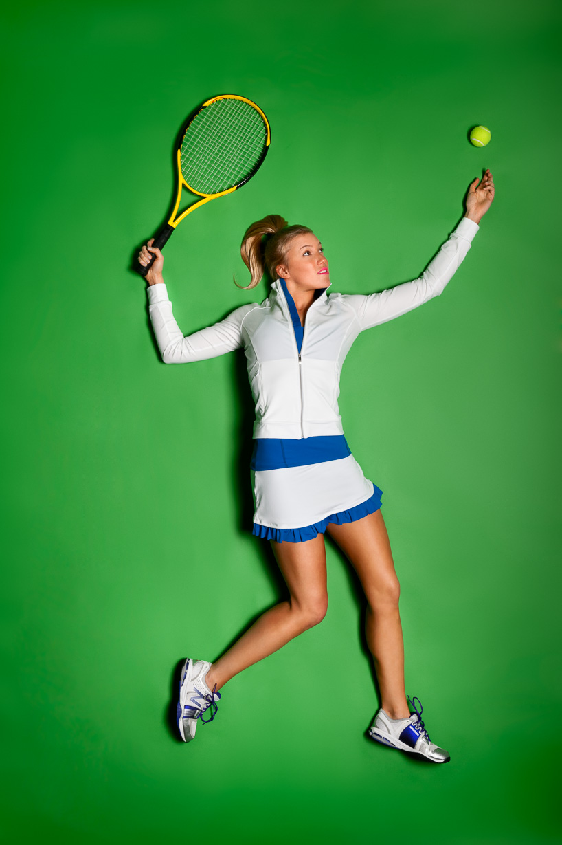 A color image of a woman wearing athletic wear playing tennis on a green background by Jeffrey Scott French